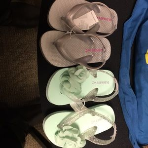 Two pairs of old navy flip flops never worn